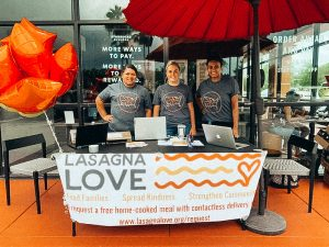 Lasagna chefs hand out meals outside of starbucks